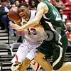 Beck Diefenbach  -  bdiefenbach@daily-chronicle.com<br /> <br /> Northern Illinois' Xavier Silas (13, left) is fouled by Ohio's Tommy Freeman (24, left) during the first half of the game at NIU's Convocation Center in DeKalb, Ill., on Wednesday Jan. 27, 2010.