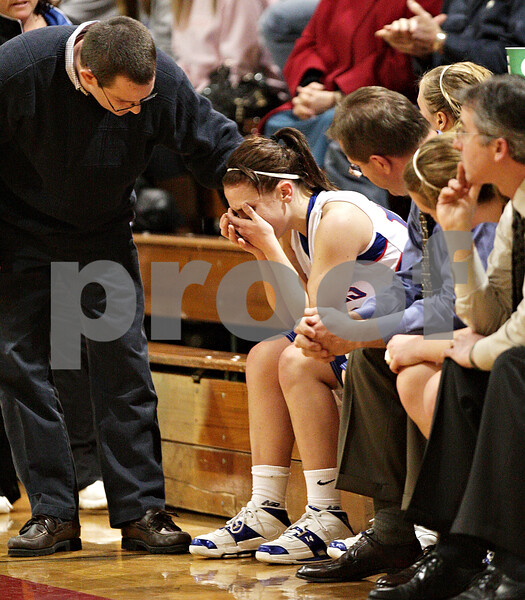 Beck Diefenbach – bdiefenbach@daily-chronicle.com<br /> <br /> Hinckley-Big Rock head coach Greg Burks (left) checks on Kaitlin Phillips after she sprained her right ankle during the second quarter of the IHSA Class 1A Regional Final game at Indian Creek High School in Shabbona, Ill., on Thursday Feb 11, 2010.