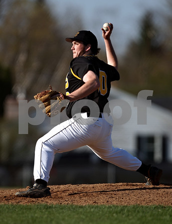 Beck Diefenbach  -  bdiefenbach@daily-chronicle.com<br /> <br /> Sycamore pitcher Trent Owens (10) throws the ball during the second inning of the game against DeKalb at DeKalb High School in DeKalb, Ill., on Friday April 9, 2010.