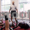 Beck Diefenbach - bdiefenbach@daily-chronicle.com<br /> <br /> Strength and conditioning coach Eric Klein leads the warm ups for  football defensive players at the Yordon Center on the Northern Illinois University Campus in DeKalb, Ill., on Tuesday Aug. 10, 2010.