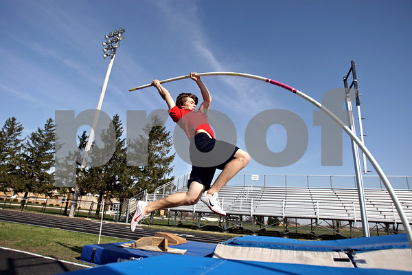 Rob Winner – rwinner@daily-chronicle.com<br /> <br /> Kaneland senior Logan Markuson practices the pole vault in Maple Park, Ill. on Thursday April 1, 2010.