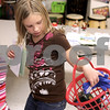 Kyle Bursaw – kbursaw@daily-chronicle.com<br /> <br /> Bianca Fant loads up another gift in her basket at the holiday shoppe at West Elementary in Sycamore on Tuesday, Dec. 21, 2010. The holiday shoppe gave students an opportunity to buy gifts for $1 each.