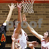 Beck Diefenbach  -  bdiefenbach@daily-chronicle.com<br /> <br /> DeKalb's Jordan Threloff (42, top) and Jake Jouris (32, right) reach for a rebound above Batavia's Elliot Vaughn (50) during the second quarter of the game at DeKalb High School in DeKalb, Ill., on Tuesday Jan. 26, 2010.
