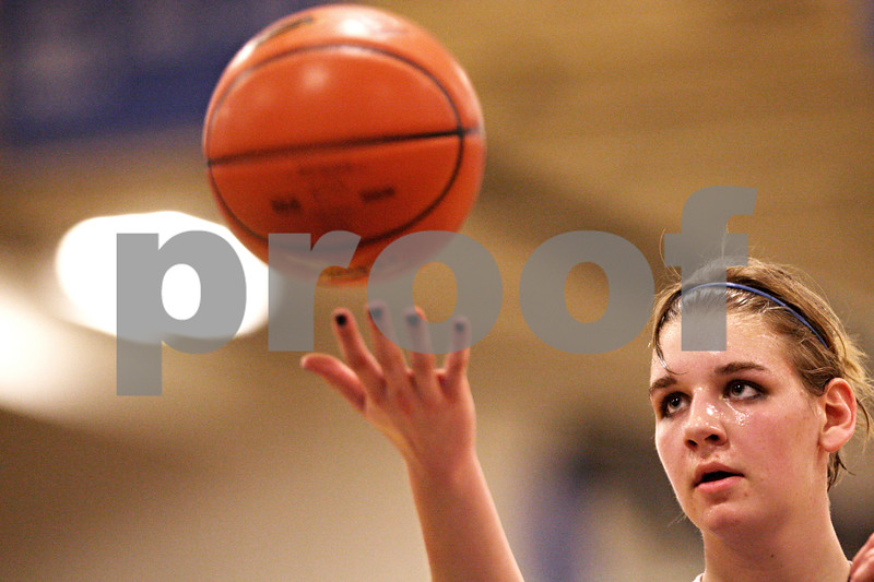 Beck Diefenbach  -  bdiefenbach@daily-chronicle.com<br /> <br /> Hinckley-Big Rock's Tess Godhardt spins the ball before shooting a free throw shot during the fourth quarter of the IHSA Class 1A Super Sectional championship game against Stockton at Judson University in Elgin, Ill., on Monday Feb. 22, 2010.