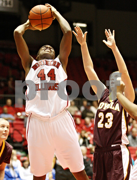 Rob Winner – rwinner@daily-chronicle.com<br /> <br /> Northern Illinois center Ebony Ellis (44) puts up a shot during the first half in DeKalb, Ill. on Tuesday, Dec. 28, 2010.