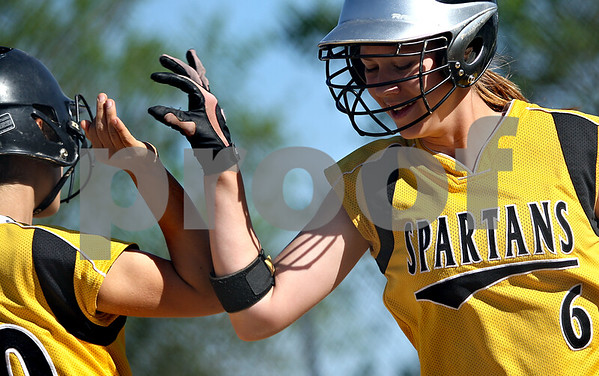 Beck Diefenbach  -  bdiefenbach@daily-chronicle.com<br /> <br /> Sycamore's Ashley Colmen (6, right) high-fives Anna Buzzard (30) after Colen scored during the second inning of the IHSA Class 2A Regional semi final game against DeKalb at Sycamore High School in Sycamore, Ill., on May 27, 2010.