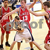 Beck Diefenbach  -  bdiefenbach@daily-chronicle.com<br /> <br /> Hiawatha's Michael Wittwer (33) is surrounded by LaMoille's Scott Taylor (13, top) and Austin Schwingle (3, right) during the third quarter of the Little Ten Tournament first round game at Somonaulk High School in Somonaulk, Ill., on Monday Feb. 1, 2010.
