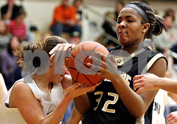 Rob Winner – rwinner@daily-chronicle.com<br /> Kaneland's Emma Bradford (left) and Sycamore's Montia Johnson fight for possession during the first half of their game in Maple Park, Ill. on Saturday February 6, 2010. Sycamore defeated Kaneland, 43-39.