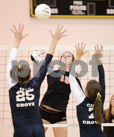 Lauren M. Anderson - landerson@nwherald.com<br /> Dekalb's Emily Bemis makes a hit against Cary-Grove during the Jacobs Class 4A Sectional on Tuesday.