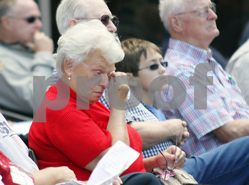 Wendy Kemp - For The Daily Chronicle<br /> Barbara Hunter, of Sycamore (left), dries her tears during the emotional 911 Memorial Service in the healing garden of Kishwaukee Hospital on Saturday.<br /> DeKalb 9/11/10
