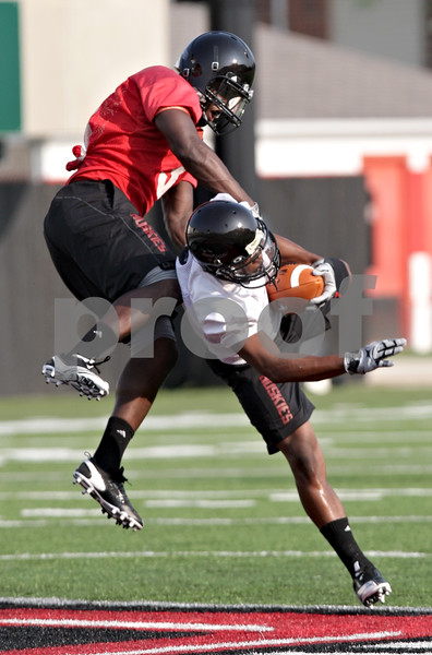 Beck Diefenbach - bdiefenbach@daily-chronicle.com<br /> <br /> Northern Illinois corner back Patrick George (33. left) and wide receiver Martel Moore (1) during the first practice at Huskie Stadium in DeKalb, Ill., on Thursday Aug. 5, 2010.