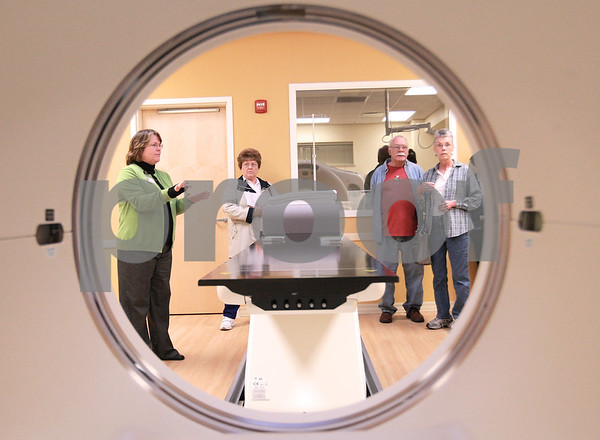 Kyle Bursaw – kbursaw@daily-chronicle.com<br /> <br /> As seen from inside the PET/CT scanner, Diagnostic Imaging Manager Jodi Haeffner, far left, explains the machine to those touring the new Kishwaukee Cancer Care Center in DeKalb, Ill. during an open house on Nov. 10, 2010.