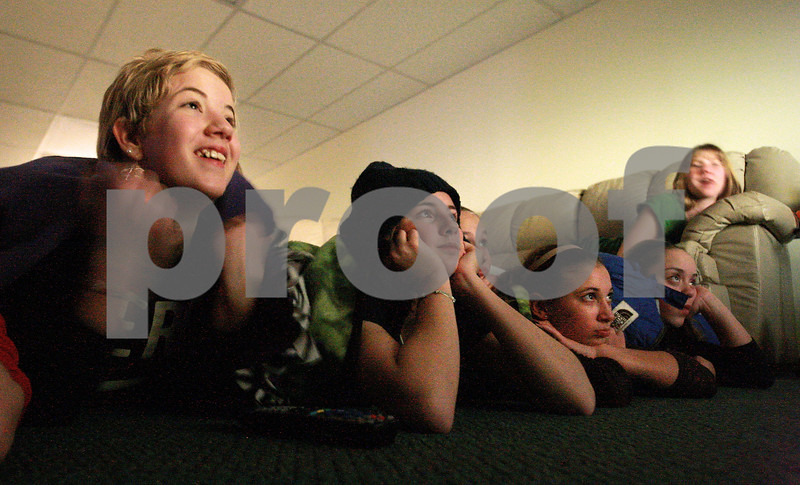 Kyle Bursaw – kbursaw@daily-chronicle.com<br /> <br /> Friends, from left, Ivy Marcrum, Alexis Van Wyne, Madison Russell, Alex Turner, Jacklyn Bouma and Josie Diehl<br /> watch 'Ghost Adventures' together under blankets. The group of girls watched the show in the dark, in Marcrum's basement in Waterman on Wednesday, Dec. 22, 2010.