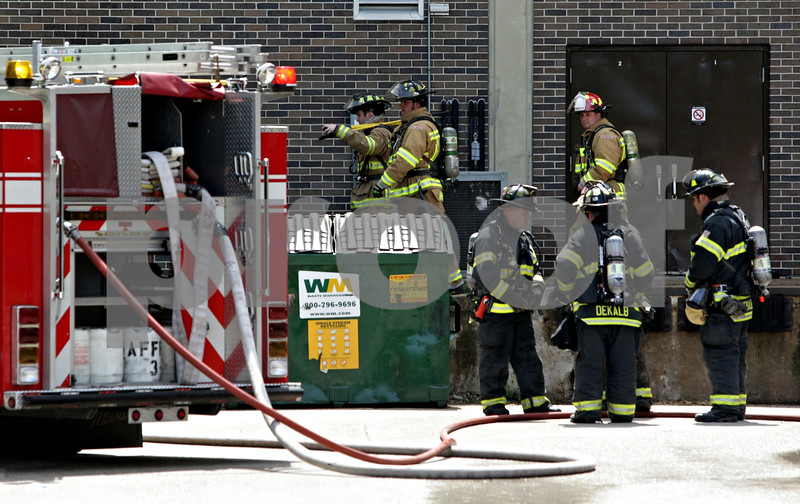 Beck Diefenbach  -  bdiefenbach@daily-chronicle.com<br /> <br /> Firefighters exit the Montgomery Building after following a fire in a lab on the fourth floor of the building on the campus of Northern Illinois University in DeKalb, Ill., on Thursday May 6, 2010.
