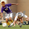 Beck Diefenbach - bdiefenbach@daily-chronicle.com<br /> <br /> DeKalb's Jon Hagelstein (9, right) stumbles as Hononegah's James Kim (11) takes control of the ball  during the second half of the game at DeKalb High School in DeKalb, Ill., on Tuesday Aug. 24, 2010. DeKalb and Hononegah tied 1 to 1.