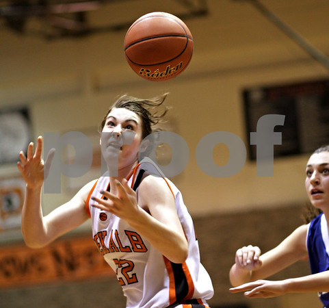 Beck Diefenbach  -  bdiefenbach@daily-chronicle.com<br /> <br /> DeKalb's Emily Bemis (22) reaches for a loose ball during the third quarter of the game against Geneva at DeKalb High School, in DeKalb, Ill., on Friday Jan. 5, 2010. Geneva defeated DeKalb 44 to 41.