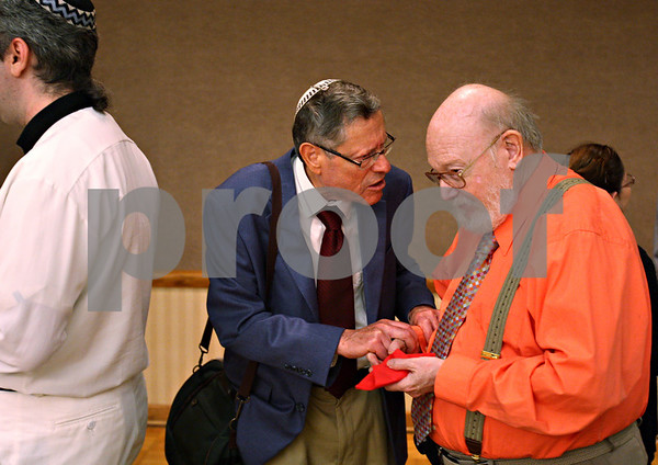 Beck Diefenbach – bdiefenbach@daily-chronicle.com<br /> <br /> Northern Illinois professors emeritus Yona Leyser (CQ), left, and Harvei Switzky  (CQ) following the Rosh Hashanah service at NIU Holmes Student Center in DeKalb, Ill., on Friday Sept. 18, 2009.