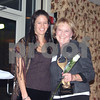 Athena Award recipient Sharon Rhoades received a rose and trophy from committee member Margo Sutorius Thursday during the Athena Awards ceremony.<br /> <br /> By NICOLE WESKERNA nweskerna@daily-chronicle.com