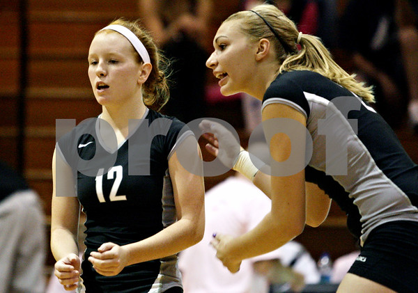 Rob Winner – rwinner@daily-chronicle.com<br /> <br /> Kaneland's Taylor Bradbury (left) and Katy Dudzinski react after a DeKalb point in the first game in DeKalb, Ill. on Tuesday October 12, 2010. DeKalb went on to defeat Kaneland, 25-18 and 25-11.