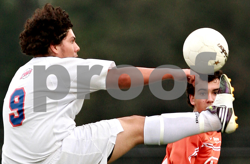 Beck Diefenbach – bdiefenbach@daily-chronicle.com<br /> <br /> A Byron defender watches as Genoa-Kingston's David Pizano (9) controls the ball during the first half of the game at G-K High School in Genoa, Ill., on Thursday Sept. 23, 2010. G-K defeated Byron 2 to 1 in overtime.