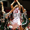 Beck Diefenbach  -  bdiefenbach@daily-chronicle.com<br /> <br /> Northern Illinois' Xavier Silas' (13, center) view is blocked by Ohio's Kenneth Van Kempen (12, left) during the first half of the game at NIU's Convocation Center in DeKalb, Ill., on Wednesday Jan. 27, 2010.