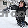 Rob Winner – rwinner@daily-chronicle.com<br /> C.J. Germain, 7, throws a snow ball at his brother, Andy (not pictured), as the two played in front of their home in DeKalb, Ill. on Tuesday February 9, 2010.