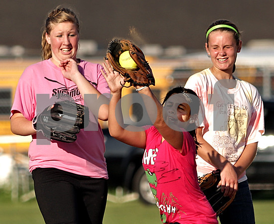 Beck Diefenbach  -  bdiefenbach@daily-chronicle.com<br /> <br /> Girls flinch during tryouts for a new travel fastpitch softball team called Sycamore Flash, at the Sycamore High School softball field in Sycamore, Ill., on Wednesday July 28, 2010.