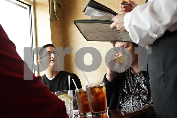 Beck Diefenbach  -  bdiefenbach@daily-chronicle.com<br /> <br /> Richard Salazar (left) orders his meal during lunch with his fiance Marlene XXX (right) and her mother XXX (not pictured) at Egg Haven in DeKalb, Ill., on  Wednesday March 10, 2010. Salazar and XXX are engaged to get married in XXX.