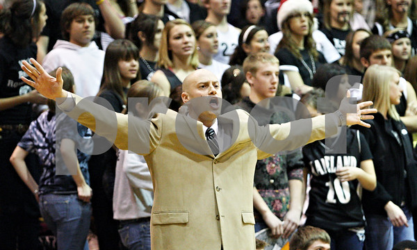 Rob Winner – rwinner@daily-chronicle.com<br /> <br /> Kaneland coach Brian Johnson tries to settle down his team during the first quarter in DeKalb, Ill. on Friday December 17, 2010.  Kaneland defeated DeKalb in the final seconds, 49-47.