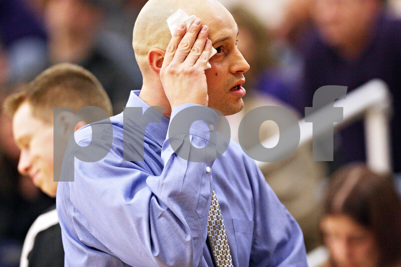 Beck Diefenbach - bdiefenbach@daily-chronicle.com<br /> <br /> Kaneland head coach Brian Johnson wipes the sweat off his forehead during the second quarter of the IHSA Class 3A semifinal regional game against Hampshire at Kaneland High School in Maple Park, Ill., on Wednesday March 3, 2010.