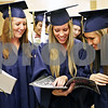 Rob Winner – rwinner@daily-chronicle.com<br /> <br /> Hiawatha graduating seniors including Diana Sanderson (from left), Joline Conro, and Breyonna Baisden look through their senior book while lining up for their graduation ceremony on Friday May 28, 2010 in Kirkland, Ill.