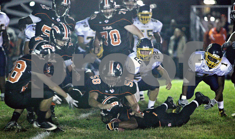 Rob Winner – rwinner@daily-chronicle.com<br /> <br /> After a fumble by Sterling running back Corey Hartz (1), DeKalb's  Spencer Blank-Jones is able to recover the loose ball for a turnover in DeKalb, Ill. on Friday September 17, 2010.