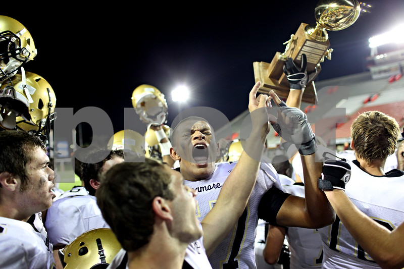 Beck Diefenbach – bdiefenbach@daily-chronicle.com<br /> <br /> Sycamore's Sam Capello (57) cheers after winning the Castle Challenge football game between DeKalb and Sycamore High Schools at Huskie Stadium on the campus of Northern Illinois University in DeKalb, Ill., on Friday Sept. 10 2010.