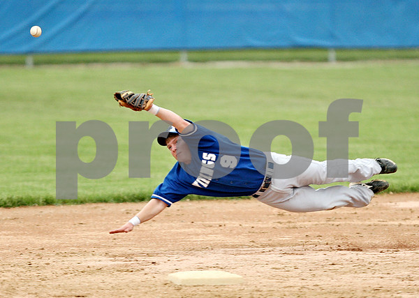Beck Diefenbach  -  bdiefenbach@daily-chronicle.com<br /> <br /> Geneva's Brian Cornick (9) is unable to catch a line drive during the seventh inning of the game against DeKalb at Geneva High School in Geneva, Ill., on Thursday May 13, 2010. DeKalb defeated Geneva 5 to 3.