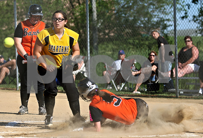 Beck Diefenbach  -  bdiefenbach@daily-chronicle.com<br /> <br /> Sycamore pitcher Abby Foulk (10, left) can't make the out as DeKalb's Tia Lexa (5) slides safe into home during the first inning of the IHSA Class 2A Regional semi final game at Sycamore High School in Sycamore, Ill., on May 27, 2010.