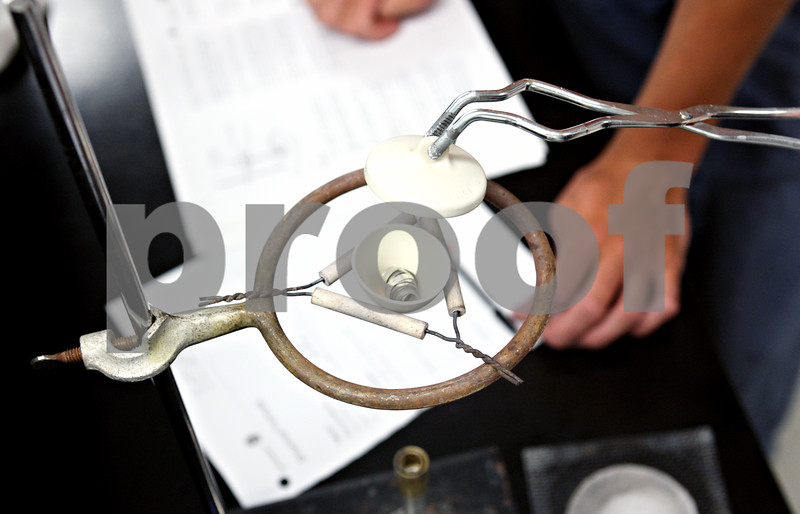 Rob Winner – rwinner@daily-chronicle.com<br /> <br /> The lid of a crucible filled with magnesium is lifted to check for a chemical reaction during a chemistry lab at Kishwaukee College in Malta, Ill. on Tuesday June 8, 2010.