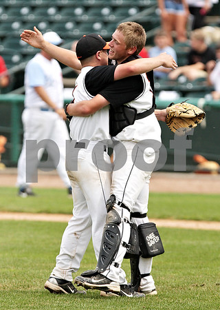 Beck Diefenbach  -  bdiefenbach@daily-chronicle.com<br /> <br /> DeKalb pitcher Jake Lemay (left) celebrates with catcher Ben Dallesasse after defeating Marian Central in the IHSA Class 3A State Semifinal Game in Joliet, Ill., on Friday June 11, 2010.