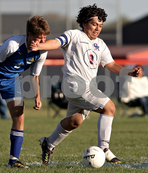 Beck Diefenbach – bdiefenbach@daily-chronicle.com<br /> <br /> Rockford Christian's Samuel Geddes (6, left) gets a taste of Genoa-Kingston's David Pizano (9) during the first half of the game at G-K High School in Genoa, Ill., on Thursday Sept. 30, 2010. G-K defeated Rockford Christian 1 to 0.