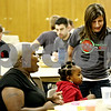 Rob Winner – rwinner@daily-chronicle.com<br /> <br /> Amanda Fabrizius (right) serves 4-year-old Missy Anderson, of DeKalb, a piece of cake during during Feed'Em Soup's first official meal serving at the First Lutheran Church of DeKalb on Friday October 13, 2010.