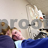 Beck Diefenbach  -  bdiefenbach@daily-chronicle.com<br /> <br /> Northern Illinois University student Philip Moe tries to relax as he donates bone marrow at Rock River Valley Blood Center in Rockford, Ill., on Thursday Feb. 18, 2010. Last April, Moe registered with the National Bone Marrow Donor Registry at NIU and was found to be a match with a needy patient.