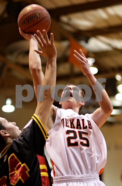 Beck Diefenbach  -  bdiefenbach@daily-chronicle.com<br /> <br /> DeKalb's (25) shoots the ball during the first quarter of the game at DeKalb High School in DeKalb, Ill., on Tuesday Jan. 26, 2010. DeKalb defeated Batavia 68 to 65 in overtime.