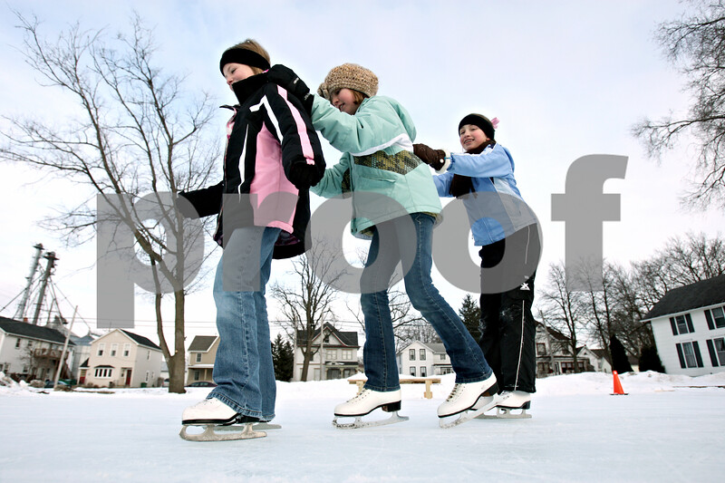 Rob Winner – rwinner@daily-chronicle.com<br /> Brooke Sunderlage (from left), 9, Autumn Routson, 10, and her sister Stephanie Routson, 12, spend the late afternoon of Saturday January 30, 2010 at the Genoa Community Ice Rink in Genoa, Ill.