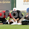 Beck Diefenbach  -  bdiefenbach@daily-chronicle.com<br /> <br /> Brian Sisler's father (far right) kneels by DeKalb's Brian Sisler is tended to after colliding with Jake Gordon during the first inning of the IHSA Class 3A State Semifinal Game against Marian Central in Joliet, Ill., on Friday June 11, 2010.
