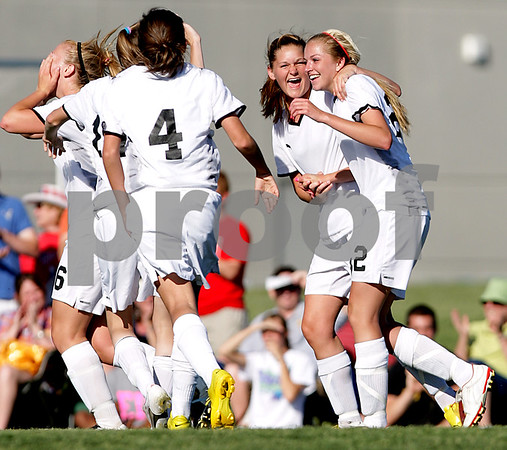 Beck Diefenbach  -  bdiefenbach@daily-chronicle.com<br /> <br /> Sycamore's Rachel Stueber (22, far right) is congratulated by Katelyn Brown (11, second from right) and the rest of the team following Stueber's three consecutive goals during the first half of the IHSA Class 2A sectional final game against Freeport at Hampshire High School in Hampshire, Ill., on Friday May 28, 2010.