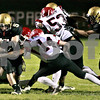 Kyle Bursaw - kburshaw@daily-chronicle.com<br /> <br /> Spartan Running Back Eric Ray tries to evade Yorkville's Steven Adler in the first quarter.