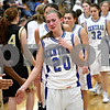 Beck Diefenbach  -  bdiefenbach@daily-chronicle.com<br /> <br /> Burlington Central's Lauren Perucco (20) leads her team in congratulating Sycamore after their win in the IHSA Class 3A Regional playoff game at Rochelle Township High School in Rochelle, Ill, on Monday Feb. 15, 2010.