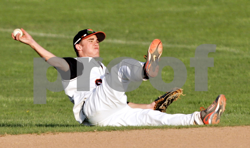 Beck Diefenbach  -  bdiefenbach@daily-chronicle.com<br /> <br /> DeKalb's Kevin Sullivan (6) attempts to throw the ball fro the ground during the seventh inning of the game against Batavia at DeKalb High School in DeKalb, Ill., on Thursday April 15, 2010. Batavia defeated DeKalb 7 to 4.