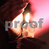 "Kyle Bursaw - kbursaw@daily-chronicle.com<br /> <br /> LaTanya Gammon, an NIU junior, shields her candle at the community gathering honoring Antinette ""Toni"" Keller Tuesday. 10.26.10"