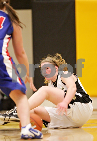 Beck Diefenbach  -  bdiefenbach@daily-chronicle.com<br /> <br /> Sycamore's Jessica Pluhm (30) trips over herself during the second quarter of the game against Glenbard South at Sycamore High School in Sycamore, Ill., on Tuesday Feb. 2, 2010.