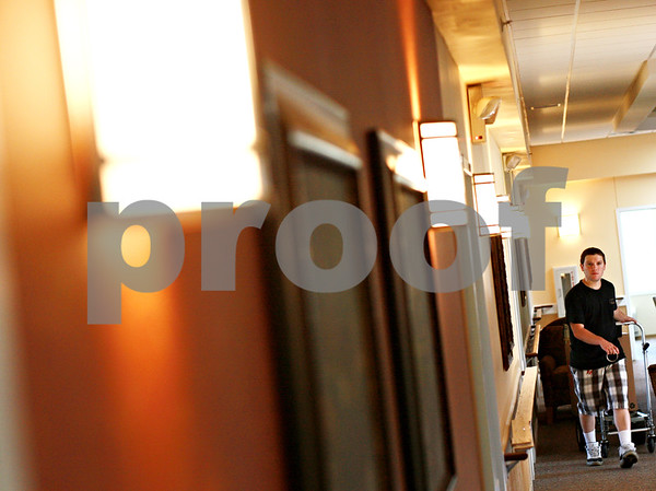 Beck Diefenbach  -  bdiefenbach@daily-chronicle.com<br /> <br /> A worker moves around furniture in the new Lincolnshire Place Alzheimer's Disease facility in Sycamore on Monday July 26, 2010.